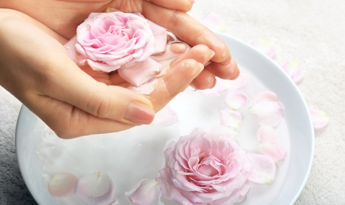 bowl with rose petals and water